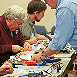 Men at an electronics workshop