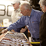 Men looking over a wing rib