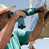A maintenance worker using a drill